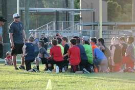 Huffman Youth Athletic Association President Alan McMullen addresses a group of campers at the HYAA football camp