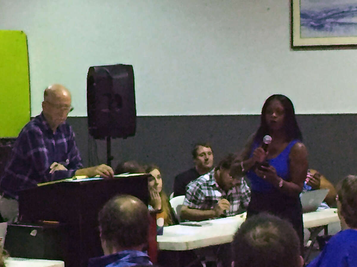Tucker Wilson speaks to a crowd of about 100 KPFT employees, board members and supporters at the station's emergency board meeting Friday, July 21, 2017.