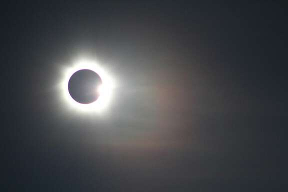 The moon slides out of alignment after a total solar eclipse over Mareeba, Australia, Nov. 14, 2012. For astrotourists, who, undaunted by the prospect of a cloudy day, travel extraordinary distances for the opportunity to glimpse the latest ex-orbital phenomena, seeing a total solar eclipse is the holy grail. (Eric Adams/The New York Times) -- PHOTO MOVED IN ADVANCE AND NOT FOR USE - ONLINE OR IN PRINT - BEFORE MARCH 31, 2013.