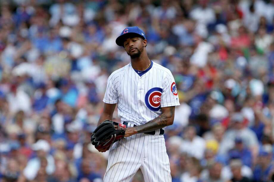 CHICAGO, IL - JULY 21:  Carl Edwards Jr. #6 of the Chicago Cubs reacts after giving up a walk in the eighth inning against the St. Louis Cardinals at Wrigley Field on July 21, 2017 in Chicago, Illinois. (Photo by Dylan Buell/Getty Images) ORG XMIT: 700011685 Photo: Dylan Buell / 2017 Getty Images