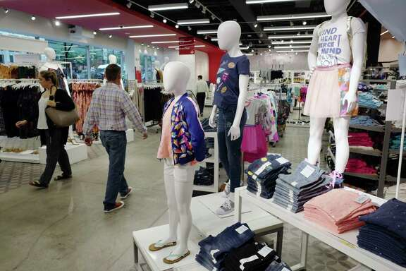 This Friday, July 14, 2017, photo shows Cat & Jack jeans and tops, made with Repreve polyester fabric created from recycled plastic bottles, on display at a Target store, in New York. A growing number of major retailers such as fast-fashion chain H&M, Target Corp. and J.C. Penney are coming out with fashions that use waste from all types of trash including plastic bottles. But price still rules for shoppers. (AP Photo/Mark Lennihan)