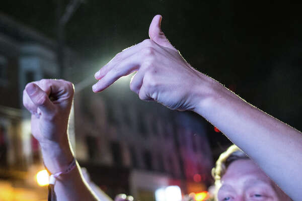 Fans recreate the Run the Jewels logo during their performance on the first day of Capitol Hill Block Party on Friday, July 21, 2017.