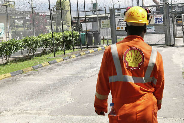 An employee approaches the entrance to the Agbada 2 oil flow station, operated by Shell Petroleum Development Co. (SPDC) in Port Harcourt, Nigeria, on Sept. 30, 2015.