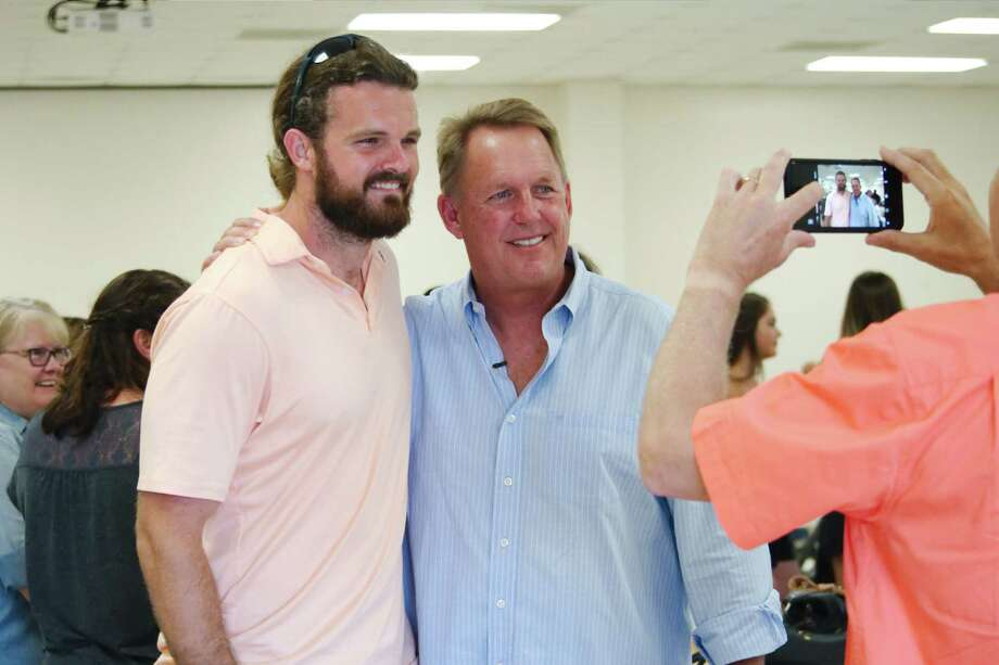 Retiring Pearland football coach Tony Heath, right, takes time to have a photo taken with former Pearland player, class of 2004, and current New Orleans Saints kicker Thomas Morstead during a Farewell To Coach Heath gathering at the Pearland Lions Club Friday, Jul 21. Photo: Kirk Sides / © 2017 Kirk Sides / Houston Chronicle
