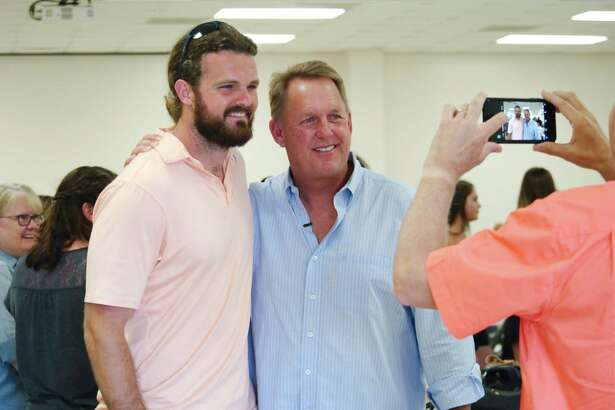 Retiring Pearland football coach Tony Heath, right, takes time to have a photo taken with former Pearland player, class of 2004, and current New Orleans Saints kicker Thomas Morstead during a Farewell To Coach Heath gathering at the Pearland Lions Club Friday, Jul 21.