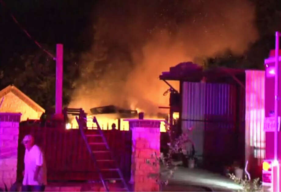 A storage building went up in flames early Saturday morning in northwest Harris County. Photo: Metro Video