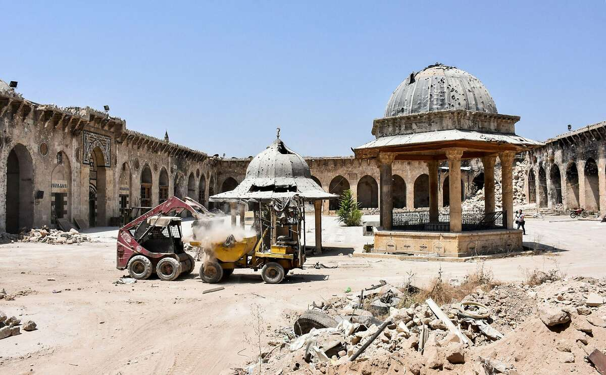 A picture taken on July 22, 2017 in the northern Syrian city of Aleppo, which was recaptured by government forces in December 2016, shows rubble being cleared from the courtyard of the ancient Great Umayyad Mosque in the old city. / AFP PHOTO / George OURFALIANGEORGE OURFALIAN/AFP/Getty Images