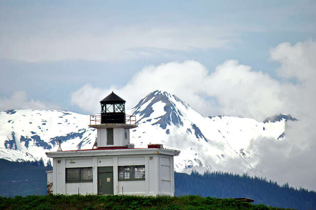 Point Retreat Lighthouse sits on Admiralty Island, where the bear to human ratio is 2 to 1. The lighthouse was named in honor of Lt. Joseph Whidbey, who went ashore during an exploration voyage and encountered natives engaged in a celebration. Not knowing if they were friendly, Whidbey quickly headed toward the island's northern tip and the safety of his ship, the HMS Discovery. After the hasty retreat, the Discovery's captain named the rocky finger of land Point Retreat.