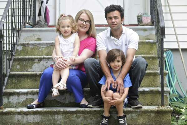 Joel Colindres with his wife Samantha and son Preston, 6, and daughter Lila,2. Friday, July 21, 2017, in New Fairfield. Colindres, a Guatemalan immigrant who is married to a U.S. citizen and has two American-born children faces deportation next month, despite years of effort to obtain legal status.