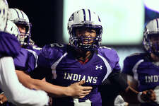 Port Neches-Groves quarterback Roschon Johnson celebrates after a touchdown run during the second quarter against College Station at Stallworth Stadium in Baytown on Friday night.  Photo taken Friday 11/25/16 Ryan Pelham/The Enterprise