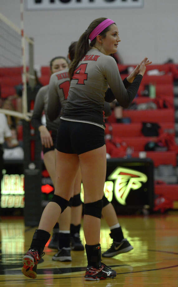 Huffman-Hargrave junior outside hitter Lauren Russell (4) pumps up her teammates against Tarkington during their district matchup at HHHS on Oct. 7, 2016. (Photo by Jerry Baker/Freelance) Photo: Jerry Baker, Freelance / Freelance