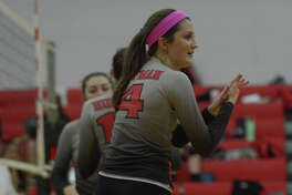 Huffman-Hargrave junior outside hitter Lauren Russell (4) pumps up her teammates against Tarkington during their district matchup at HHHS on Oct. 7, 2016. (Photo by Jerry Baker/Freelance)