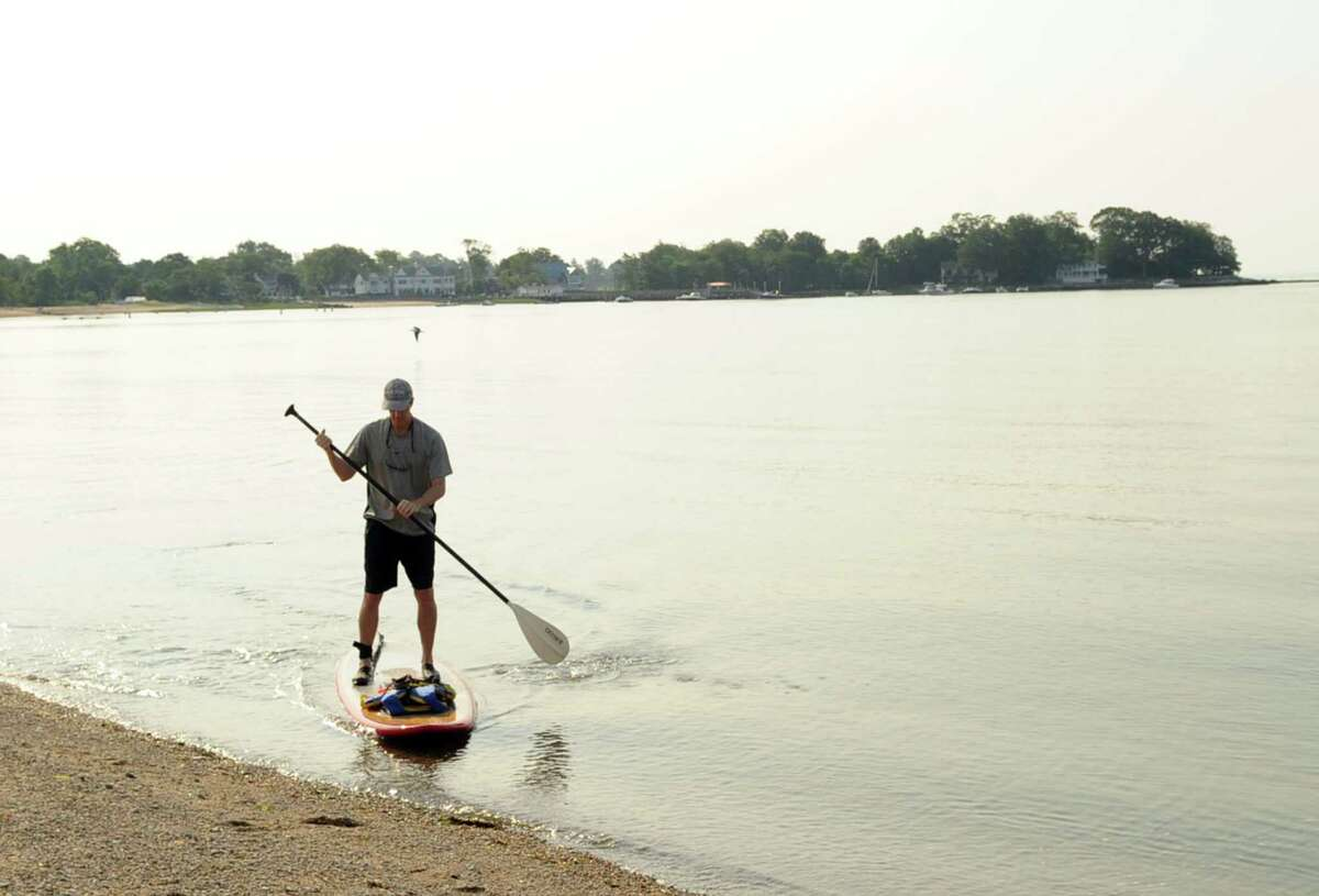 Start your morning with some socially-distanced exercise like paddle boarding on the Sound...
