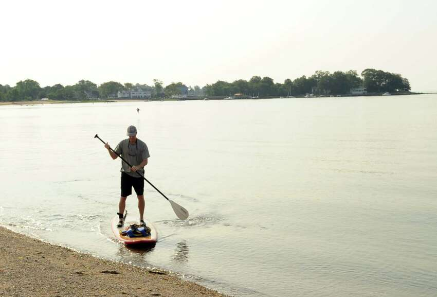 Start your morning with some exercise like paddle boarding on the Sound...