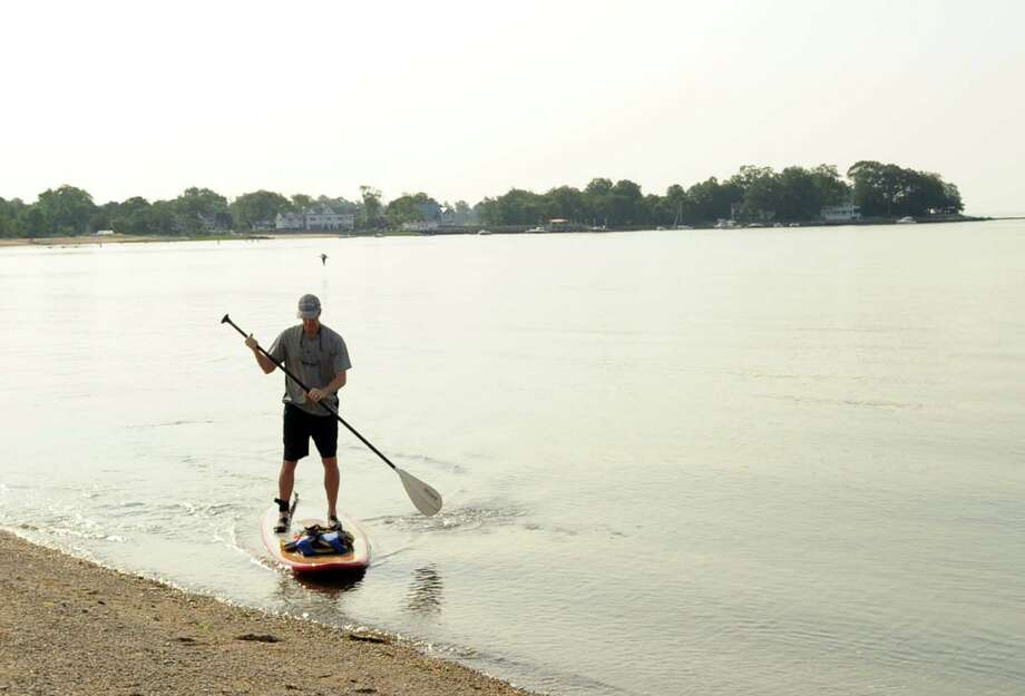 Start your morning with some exercise like paddle boarding on the Sound... Photo: Bob Luckey Jr., Hearst Connecticut Media / Greenwich Time