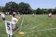 The annual Greenwich Wiffleball tournament at the Eastern Greenwich Civic Center in Old Greenwich, Conn., Saturday, July 22, 2017.  The newly-named tournament is now officially called the Garden Catering Wiffleball Tournament after the lead sponsor and has moved from the Greenwich Polo Club to the playing fields of the Eastern Greenwich Civic Center.