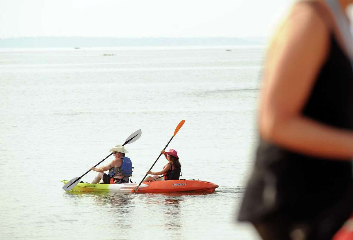 """Robert and Carol Stroh, husband and wife of Yonkers, N.Y. paddle their kayak in Long Island Sound as they participated in the SoundWaters Flotilla Fundraising Event to protect Long Island Sound, a kayak and paddle board event that started from Cove Island Park in Stamford, Conn., Saturday morning, July 22, 2017. The paddlers finished their 4-mile voyage of Long Island Sound on the west side of Stamford at Boccuzzi Park. Leigh Shemitz, president of SoundWaters said """"we are doing the event to celebrate and protect Long Island Sound, our region and Stamford's greatest natural resource."""" Money raised went to support the SoundWaters education programs."""