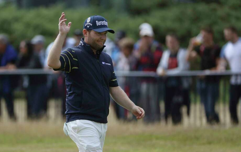 South Africa's Branden Grace waves as he makes his way along the 18th fairway during the third round of the British Open Golf Championship, at Royal Birkdale, Southport, England, Saturday July 22, 2017. (AP Photo/Peter Morrison) Photo: Peter Morrison, STR / Copyright 2017 The Associated Press. All rights reserved.