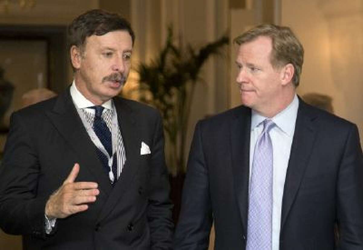 Stan Kroenke, owner of the St. Louis Rams, talks with NFL Commissioner Roger Goodell during a league meeting in Washington, Oct. 8.