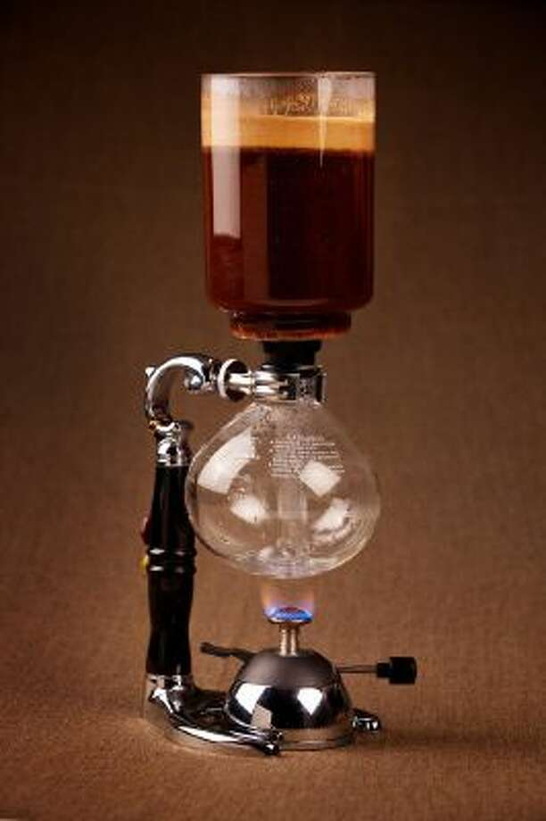 A quest for the perfect home-brewed coffee. Among the author?s collection: The siphon brewer combines gadgetry-geek chic with full-flavor extraction.