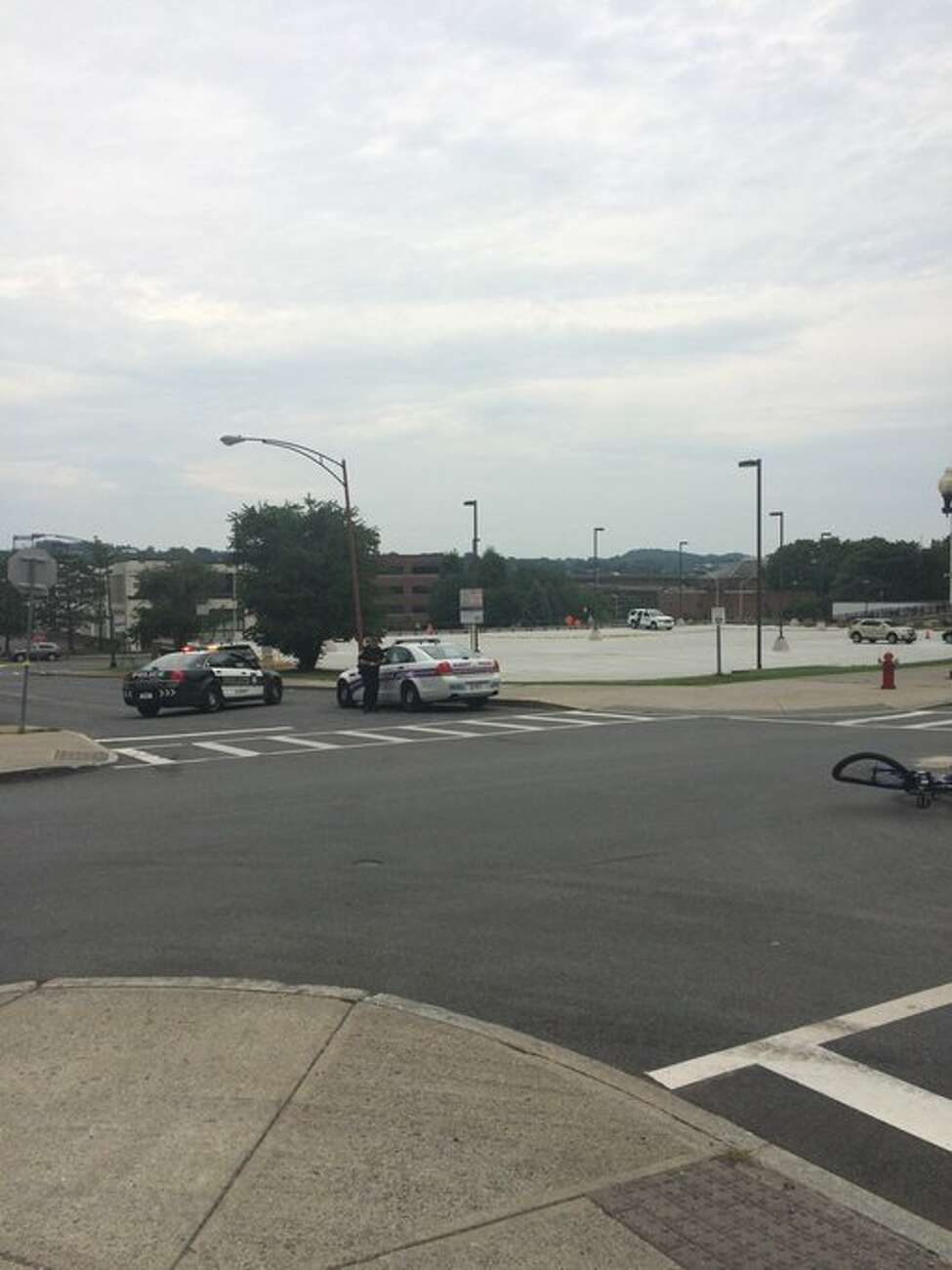 Albany police respond to bicycle and bus collision at corner of Wilson and N. Pearl streets on Saturday, July 22, 2017. (Leigh Hornbeck/Times Union)