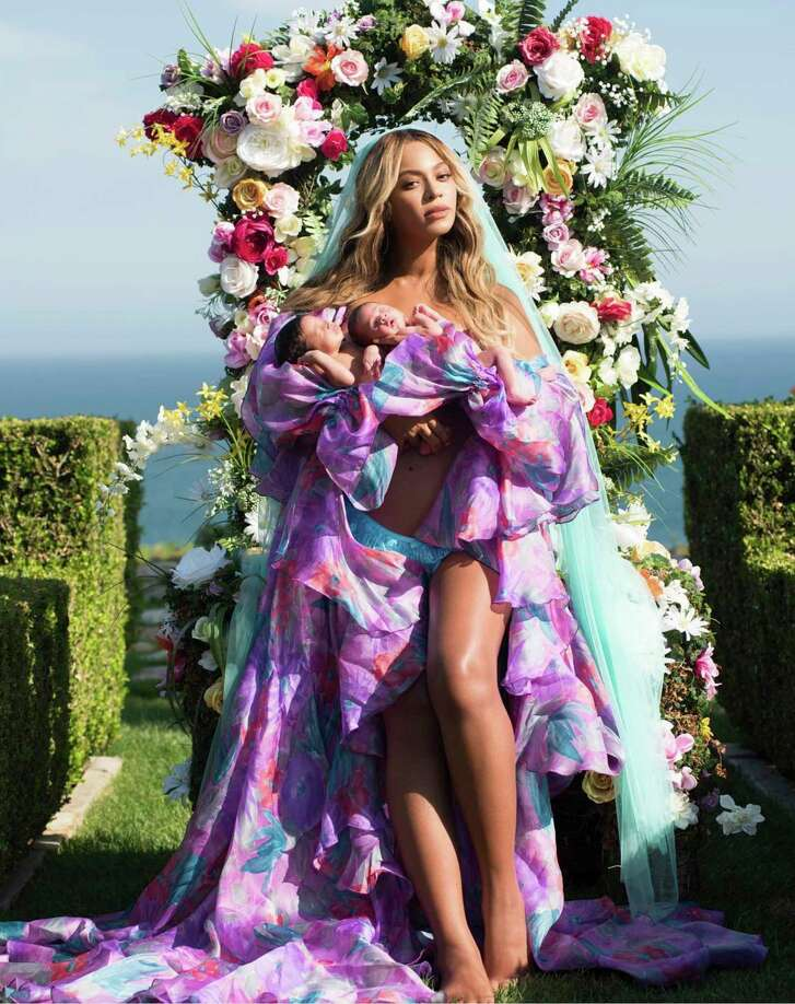 "In this undated image released by Parkwood Entertainment on Friday, July 14, 2017, Beyonce posed with her newborn twins Sir Carter and Rumi. The singer posted the picture on Instagram late Thursday night and wrote in the caption, ""Sir Carter and Rumi 1 month today."" She didn't mention the babies' genders, but Beyonce's mother wrote on Instagram that the pop star had given birth to a boy and a girl.  (Mason Poole/Parkwood Entertainment via AP)"