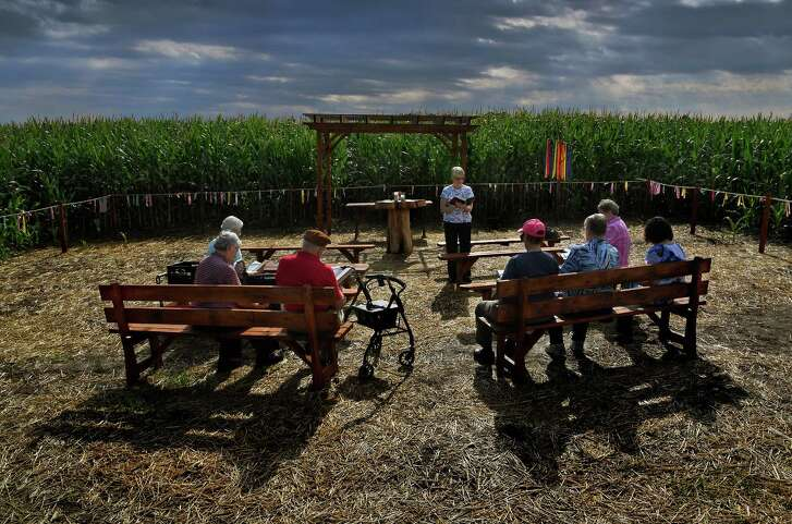Sister George Ann Biskan leads a group of nuns and supporters during a prayer service at a chapel in a Columbia, Pa., cornfield.