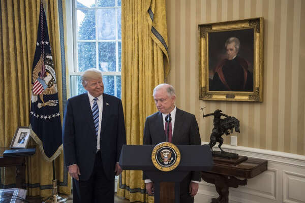 President Trump at the swearing-in ceremony for Attorney General Jeff Sessions in February. Sessions had initially failed to disclose his meetings with Russian Ambassador Sergey Kislyak during his confirmation process.