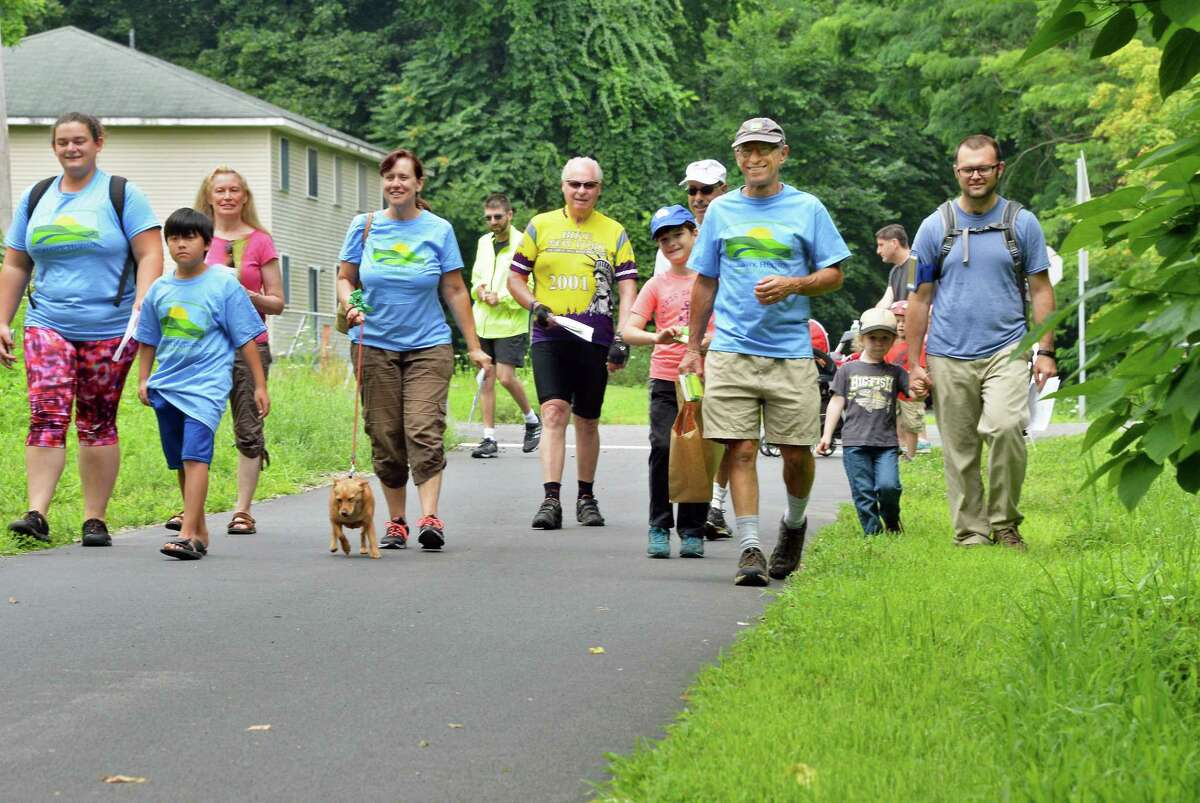 Mohawk Hudson Land Conservancy volunteer Miles Garfinkel, 2nd from right, leads a nature and history hike along the Albany County Helderberg-Hudson Rail Trail Saturday July 22, 2017 in Delmar, NY. (John Carl D'Annibale / Times Union)