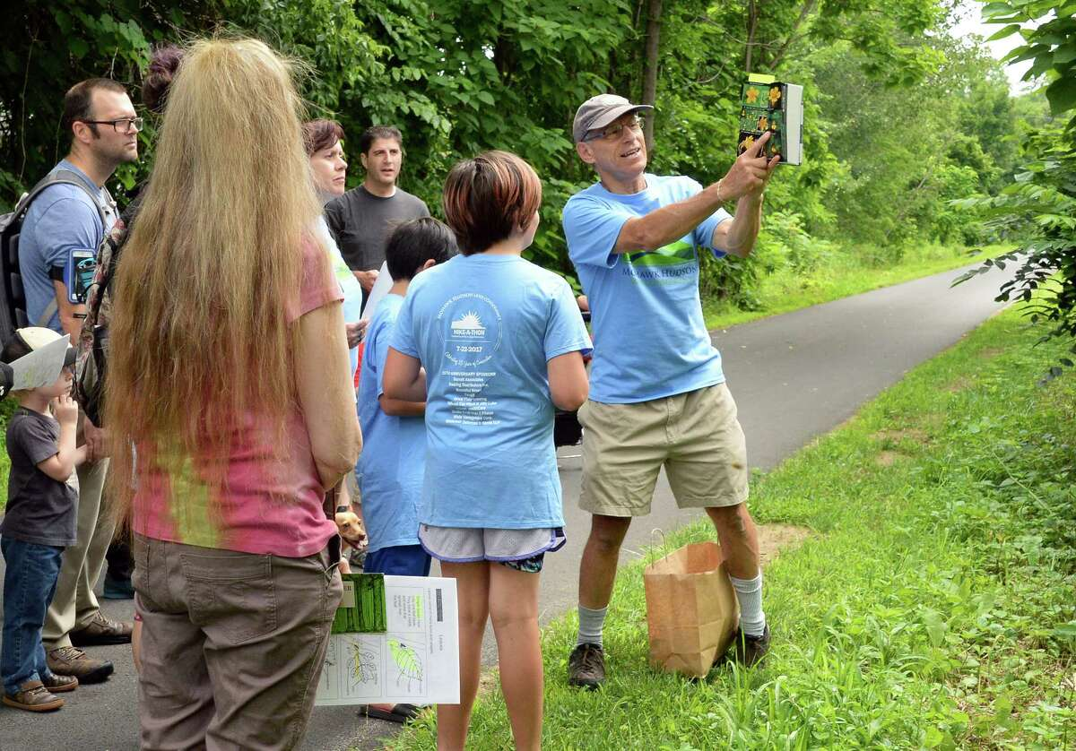 Mohawk Hudson Land Conservancy volunteer Miles Garfinkel, right, leads a nature and history hike along the Albany County Helderberg-Hudson Rail Trail Saturday July 22, 2017 in Delmar, NY. (John Carl D'Annibale / Times Union)