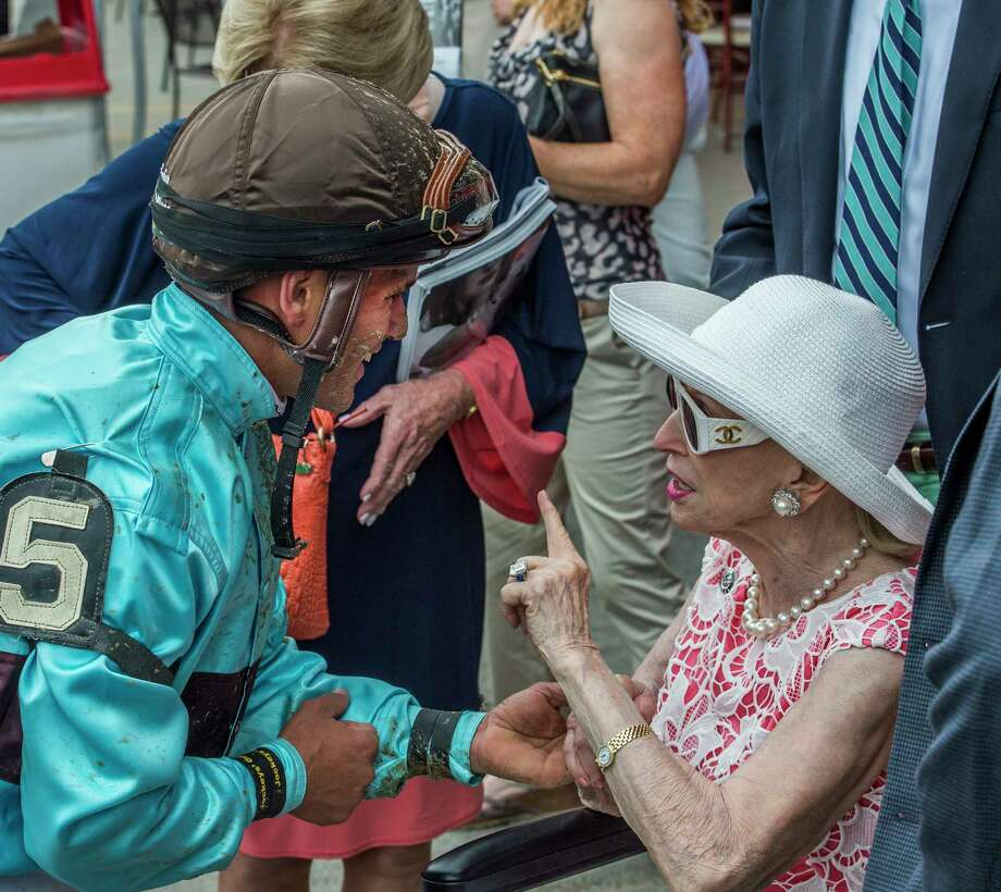 Mary Lou Whitney, right speaks with her jockey Javier Castellano, left after her horse Adulation finished fourth Saturday July 23, 2017 at the Saratoga Race Course in Springs, N.Y. (Skip Dickstein/Times Union Photo: SKIP DICKSTEIN, Albany Times Union