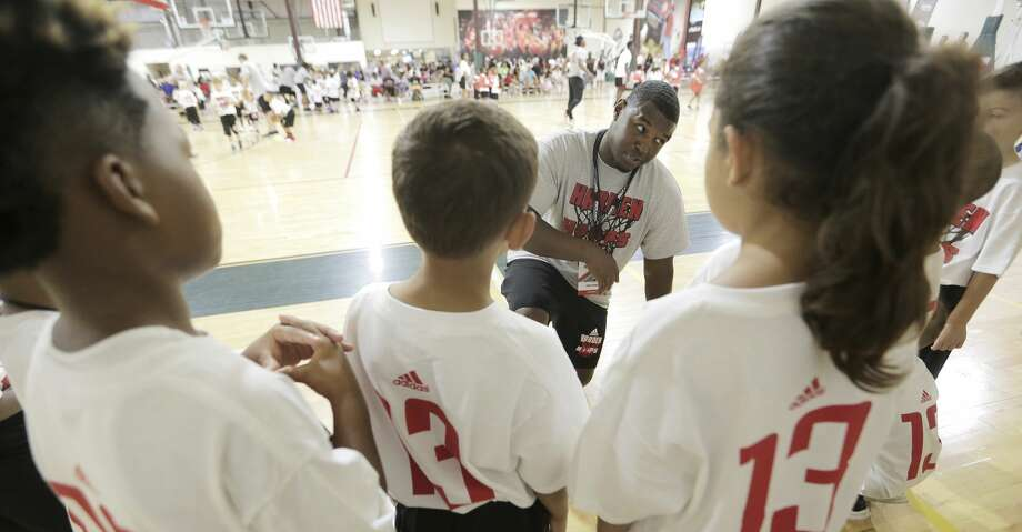 Coach Stephen Woods talks to his team about passing before scrimmaging during James Harden Basketball Procamp on Saturday, July 22, 2017, in the Woodlands. ( Elizabeth Conley / Houston Chronicle ) Photo: Elizabeth Conley/Houston Chronicle