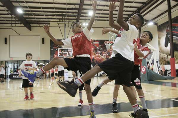 Kendrick Watson, 11, snags a rebound during James Harden Basketball Procamp on Saturday, July 22, 2017, in the Woodlands. ( Elizabeth Conley / Houston Chronicle )