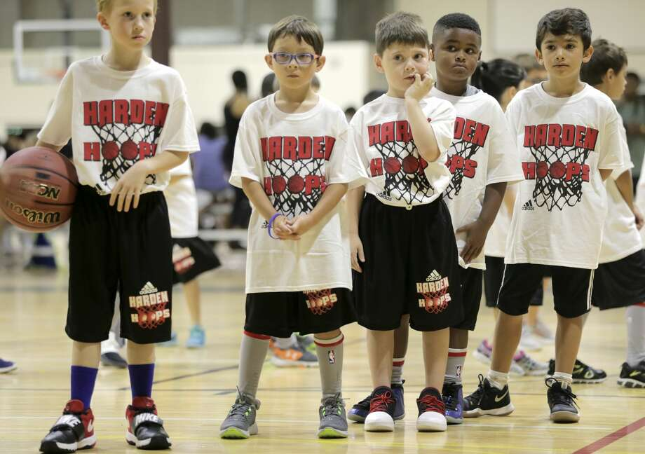 Participants James Harden Basketball Procamp listen to their instructor during a drills on Saturday, July 22, 2017, in the Woodlands. ( Elizabeth Conley / Houston Chronicle ) Photo: Elizabeth Conley/Houston Chronicle