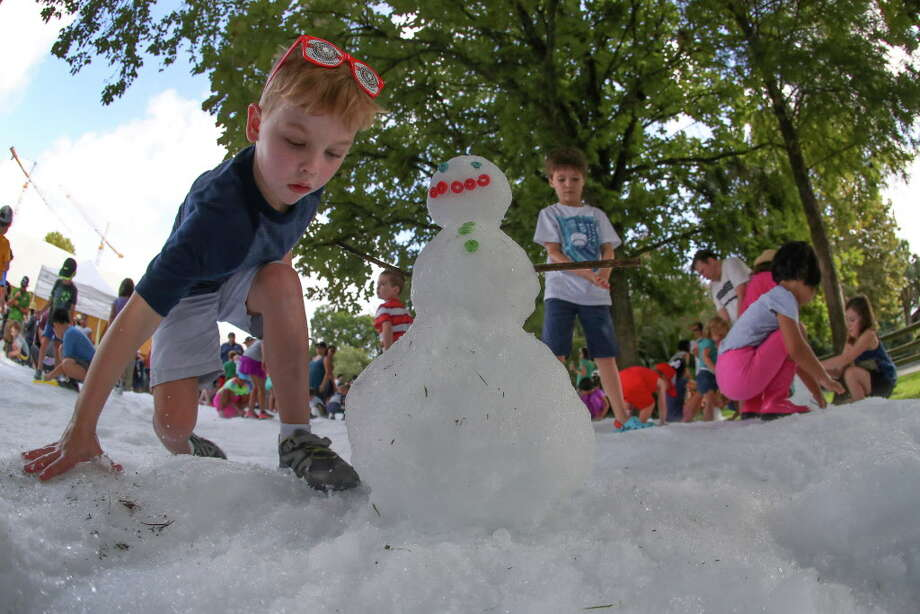Keegan Gray, 6, slips on the snow during Snow Days at the Zoo sponsored by Sunny 99.1 and TXU Energy Presents Chill Out at the Houston Zoo Saturday, July 22, 2017, in Houston.  Guests can also enjoy the event Sunday, July 23, from 9:00 a.m. until noon (or until the Texas heat melts it away). The two day event featured two snow fields located at Karamu Outpost; a smaller field for the little ones and a larger field for the bigger kids, so this event is fun for the entire family. Kids of all ages created their own snowman, made a snow angel or simply enjoy the cold snow on a hot summer's day. Photo: Steve Gonzales, Houston Chronicle / © 2017 Houston Chronicle