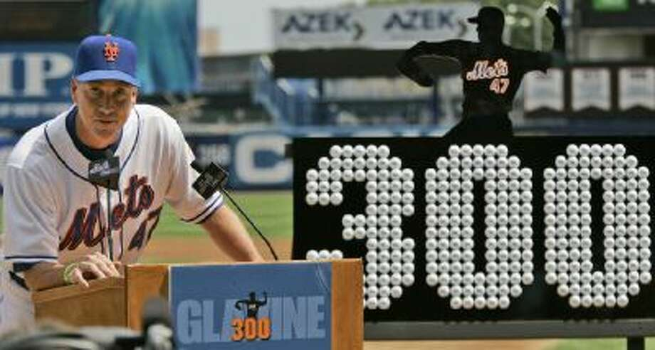 New York Mets pitcher Tom Glavine speaks during a ceremony honoring his achievement of 300 victories before the Mets baseball game against the Florida Marlins at Shea Stadium in New York, Sunday, Aug. 12, 2007. A plaque made of golf balls presented to Glavine by his teammates is displayed at right.