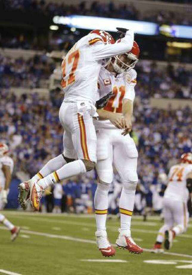 After scoring a touchdown against the Indianapolis Colts, Kansas City Chiefs wide receiver Donnie Avery (17) celebrates with quarterback Alex Smith.