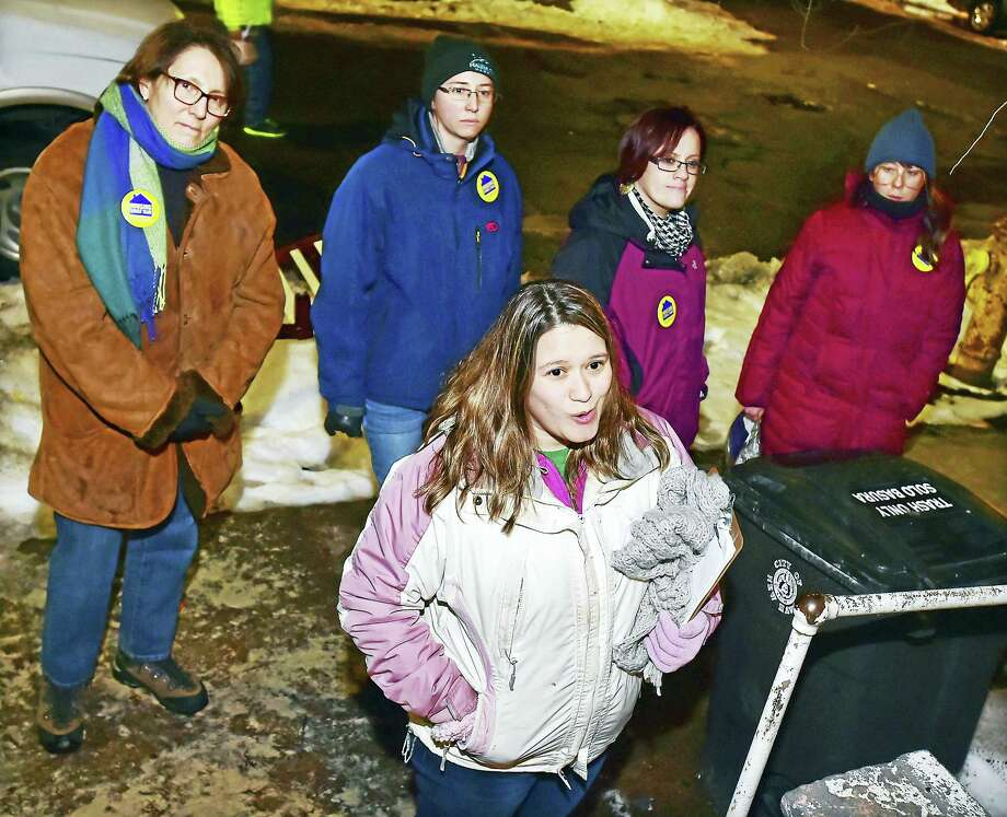 (Catherine Avalone - New Haven Register) Veronica Cruz, the team leader talks to residents on Lloyd Street in the Fair Haven section of New Haven about their knowledge of the homeless in the neighborhood, during the 2016 Point in Time - Homeless Count, Tuesday, January 26, 2016. Members of the team, Dr. Lucile Burgo, a primary care physician with VA Connecticut, Katie Kenney, CT Coalition to End Homelessness, Jennifer Olivieri, West Haven VA and Sarah Lipkin, a nurse practicioner at VA Connecticut's Errera Community Care Center in West Haven walked through the streets of Fair Haven looking for homeless. The count helps inform efforts to end homelessness in the state. Photo: Journal Register Co. / New Haven RegisterThe Middletown Press