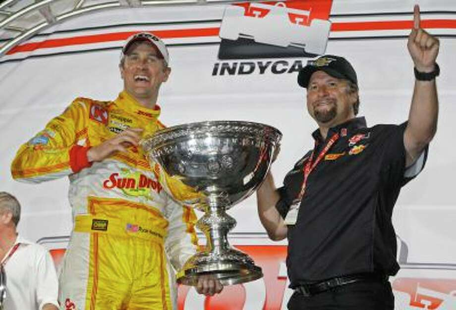 FILe - In this Sept. 15, 2012 file photo, Ryan Hunter-Reay, left, and team owner Michael Andretti celebrate his season victory in the MAVTV IndyCar World Championships auto race at Auto Club Speedway in Fontana, Calif. Andretti Autosport announced Wednesday, July 17, 2013, it has signed on as the third team to compete in the environmentally friendly FIA Formula E championship, which will feature electric cars racing in 10 cities around the world beginning in 2014. Michael Andretti's two-car operation will join China Racing and British-based Drayson Racing as organizations already committed to a field that will have 10 two-car teams competing in each e-Prix. (AP Photo/Reed Saxon, File) Photo: AP / AP