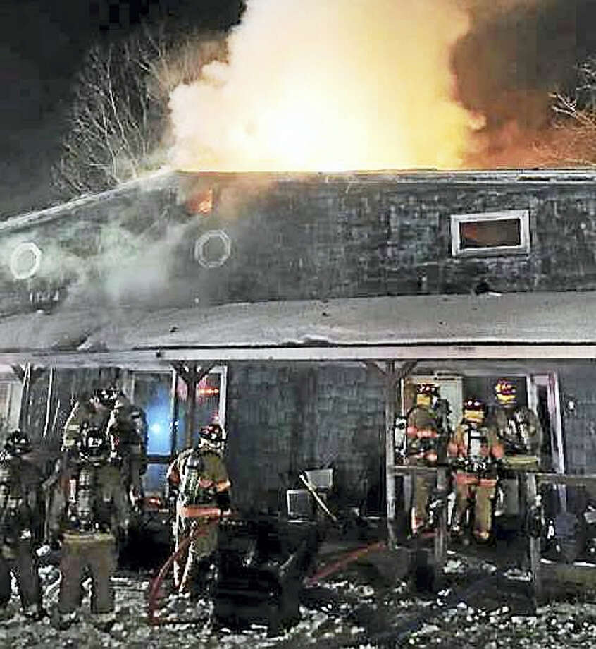 Photos from Beacon Hose Co. #1 Firefighters from Oxford, Seymour, Southbury, Beacon Falls and Monroe were all called in to help Tuesday night after a fire broke out at a home on Christian Street. One firefighter was reportedly hurt while fighting the fire. Photo: Journal Register Co.