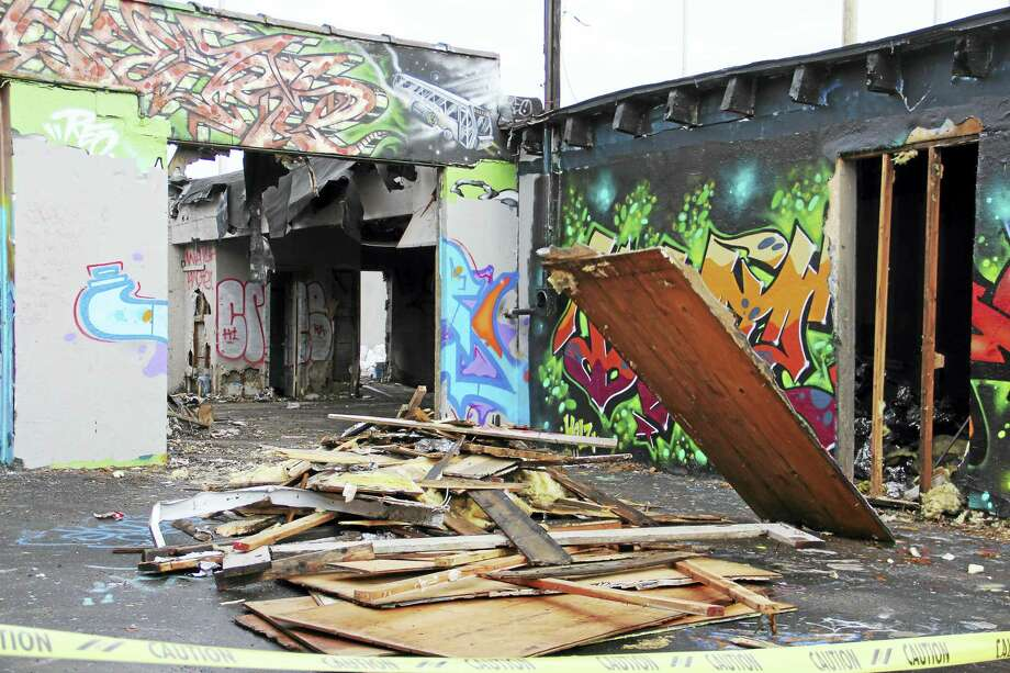 The facility at 159 Water St., also known as the Hi Cru wall, is being razed after a fire exposed further complications to the vacant building in downtown New Haven. The building is known for its colorful graffiti art. Esteban L. Hernandez New Haven Register Photo: Journal Register Co.