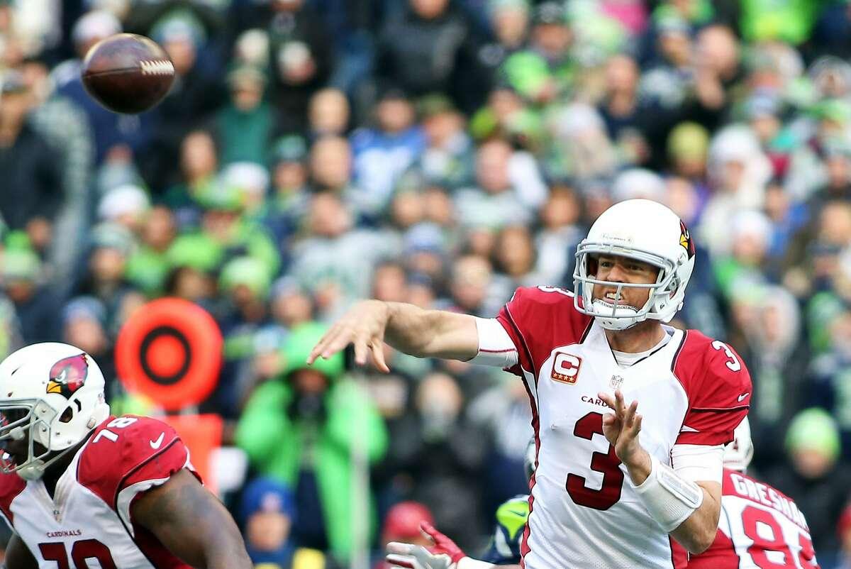 Cardinals quarterback Carson Palmer throws during the first half of Seattle's game against Arizona, Saturday, Dec. 24, 2016 at CenturyLink Field. (Genna Martin, seattlepi.com)
