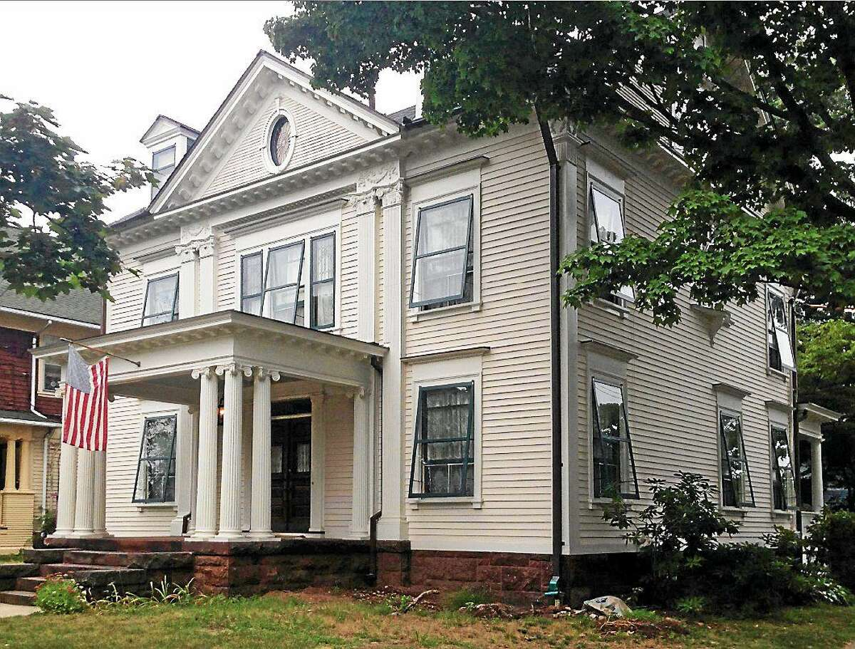 (Contributed photo) The Moritz Spier House at 678 Orange St., New Haven, owned by GIna and Robert Naracci who are both architects. They were given the New Haven House Preservation Award for their seven years of work bringing it back to its original look. It was built in 1895