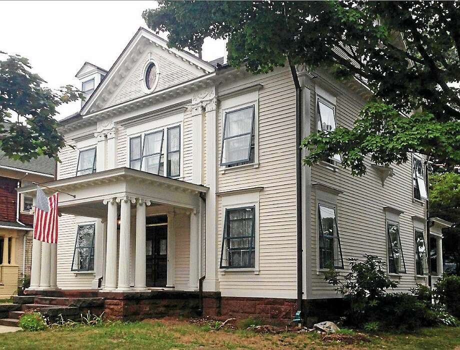 (Contributed photo) The Moritz Spier House at 678 Orange St., New Haven, owned by GIna and Robert Naracci who are both architects. They were given the New Haven House Preservation Award for their seven years of work bringing it back to its original look. It was built in 1895 Photo: Journal Register Co.