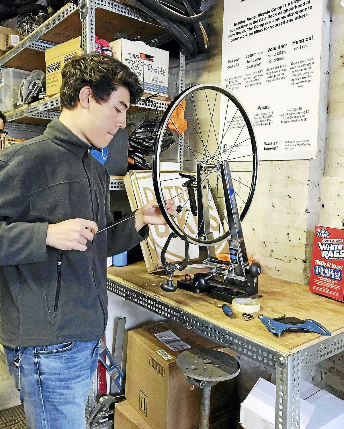 Andrew Suzuki Is one of the main volunteers at the Bradley Street Bicycle Cooperative.Mary O'Leary - New Haven Register