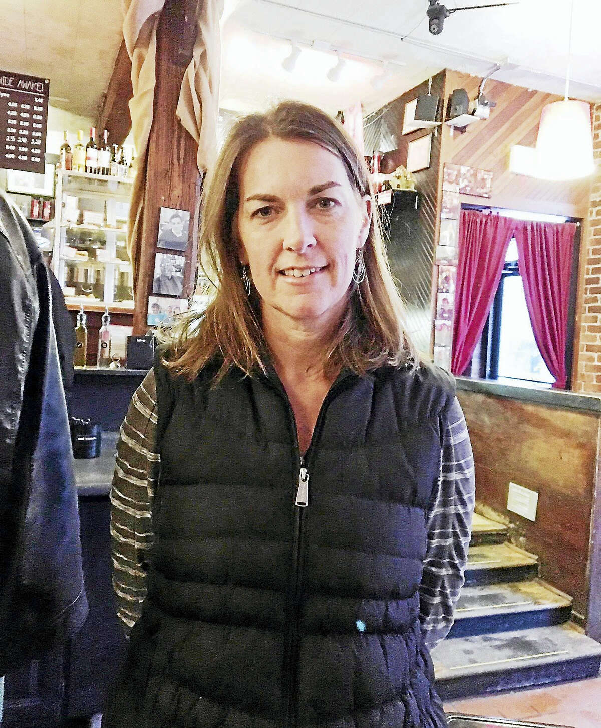 Sandy Parkerson, a volunteer at Integrated Refugee and Immigrant Services, helps refugees obtain bicycles for transportation.Mary O'Leary - New Haven Register