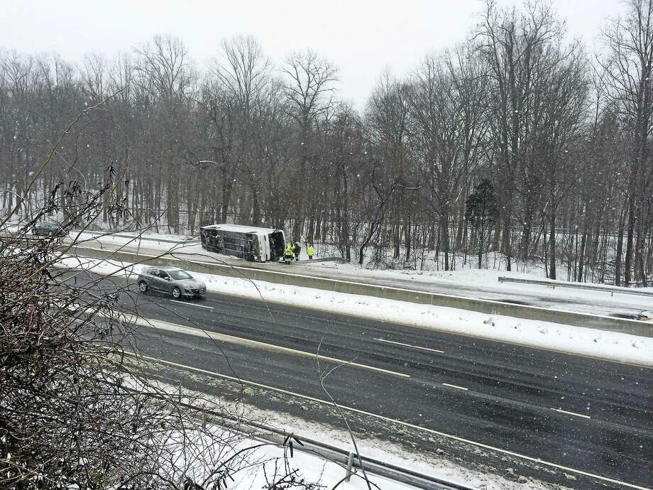 Part of Interstate 95 northbound was shut down early Monday afternoon after a tour bus rolled over and crashed. ( Sarah Kyrcz ) Photo: Journal Register Co.