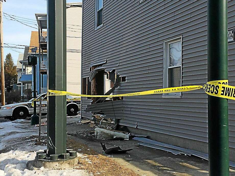 Crews will begin on Wednesday morning the job of erecting a $3,000 barrier in front of 91 Winchester Ave. The house has been hit three times in the last three years by vehicles traveling east on Webster Street, most recently in March (pictured). (Wes Duplantier - New Haven Register) Photo: Journal Register Co.