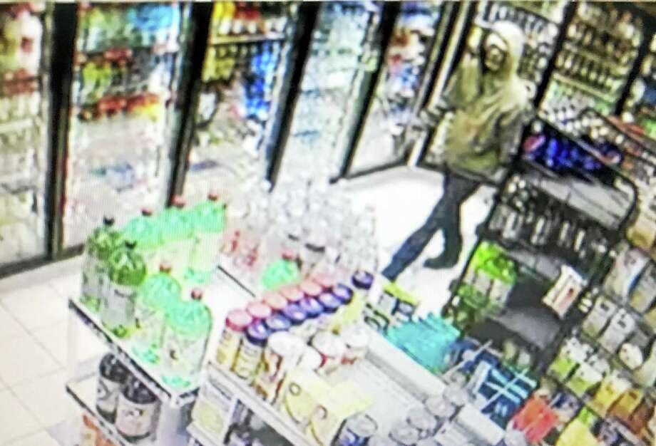 Courtesy of Connecticut State PolicePolice are looking for help identifying a suspect who robbed Jo Jo's Food Mart-Valero at 1309 Route 1 in Westbrook on Tuesday evening. Photo: Digital First Media