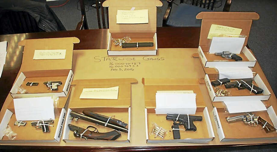 Guns and drugs seized by police in Bridgeport.  CONNECTICUT STATE POLICE Photo: Journal Register Co.
